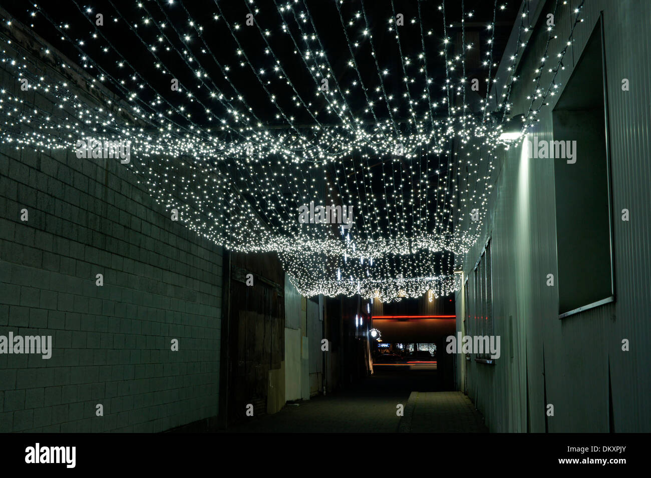 white christmas lights hanging in an alley in the railspur district granville island vancouver