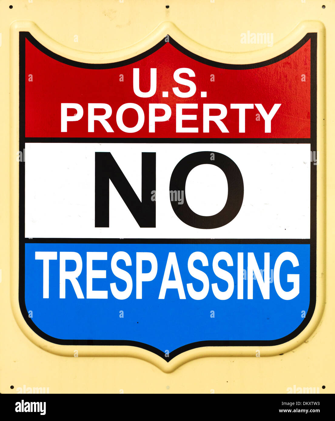 US Property No Trespassing sign on the side of a Federal building in downtown Miami, Florida, USA - Stock Image