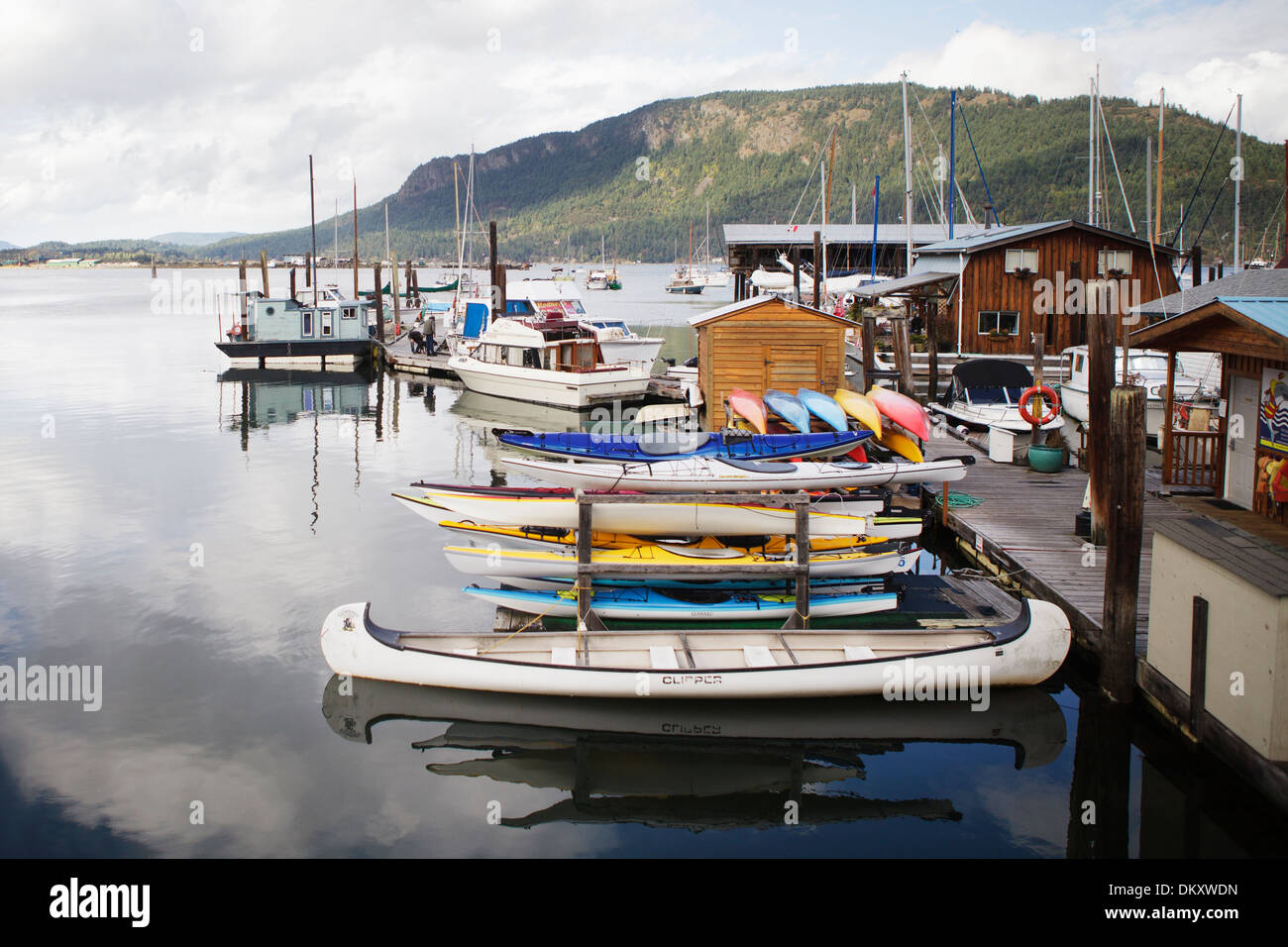 Boats and homes in a colorful Marina on Vancouver island. - Stock Image