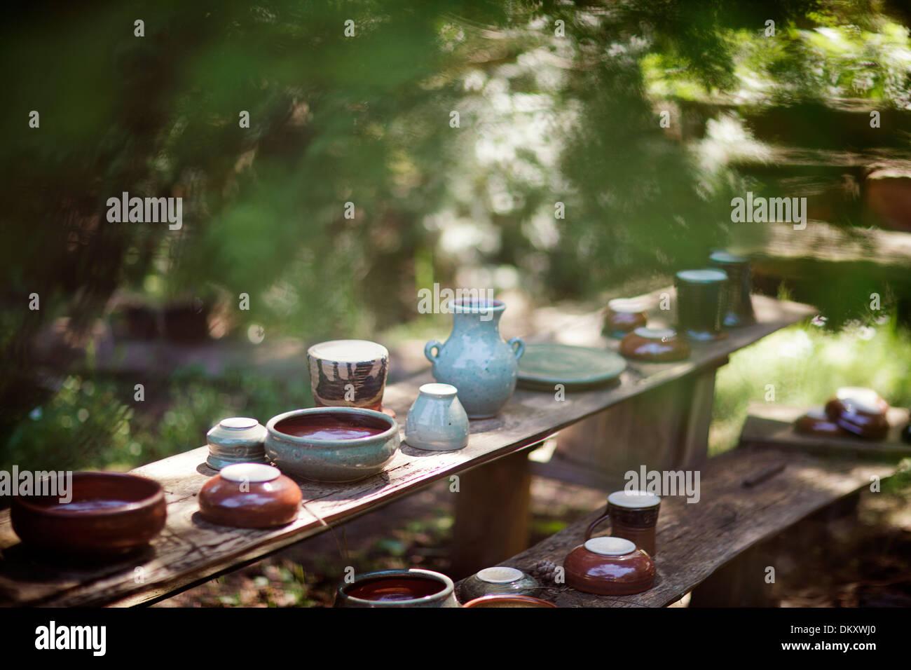 Handmade Pottery on a rustic wood shelf. - Stock Image
