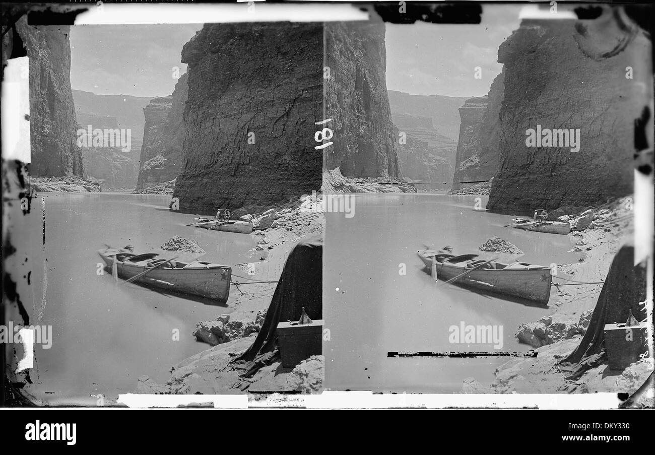 Colorado River. Marble Canyon, 1872. Shows two boats anchored, one with Major Powell's chair with the two life... 518002 - Stock Image