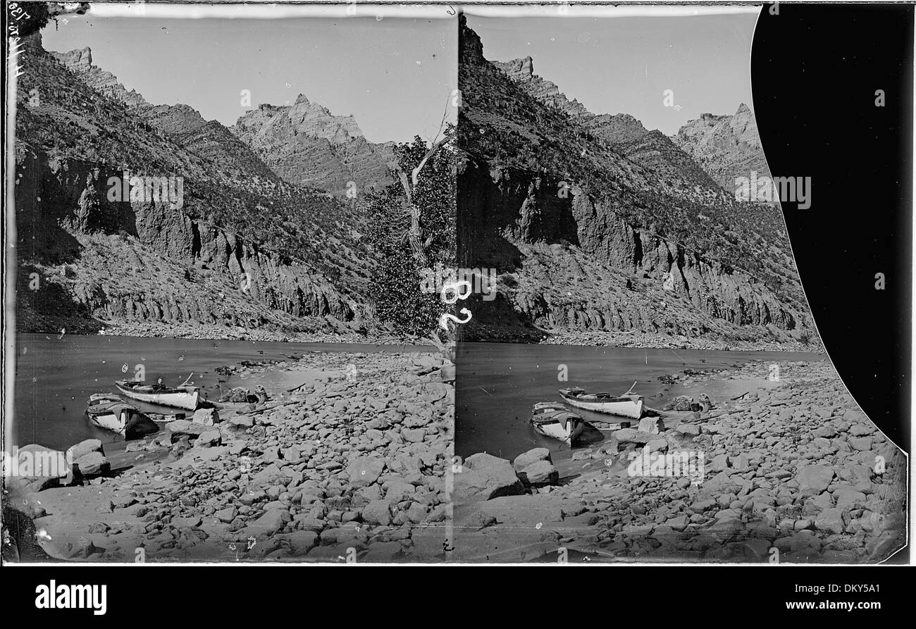 Green River. Split Mountain Canyon, not far from no. 694, above it. Photo shows two boats anchored, 1871 Expedition... 517938 - Stock Image