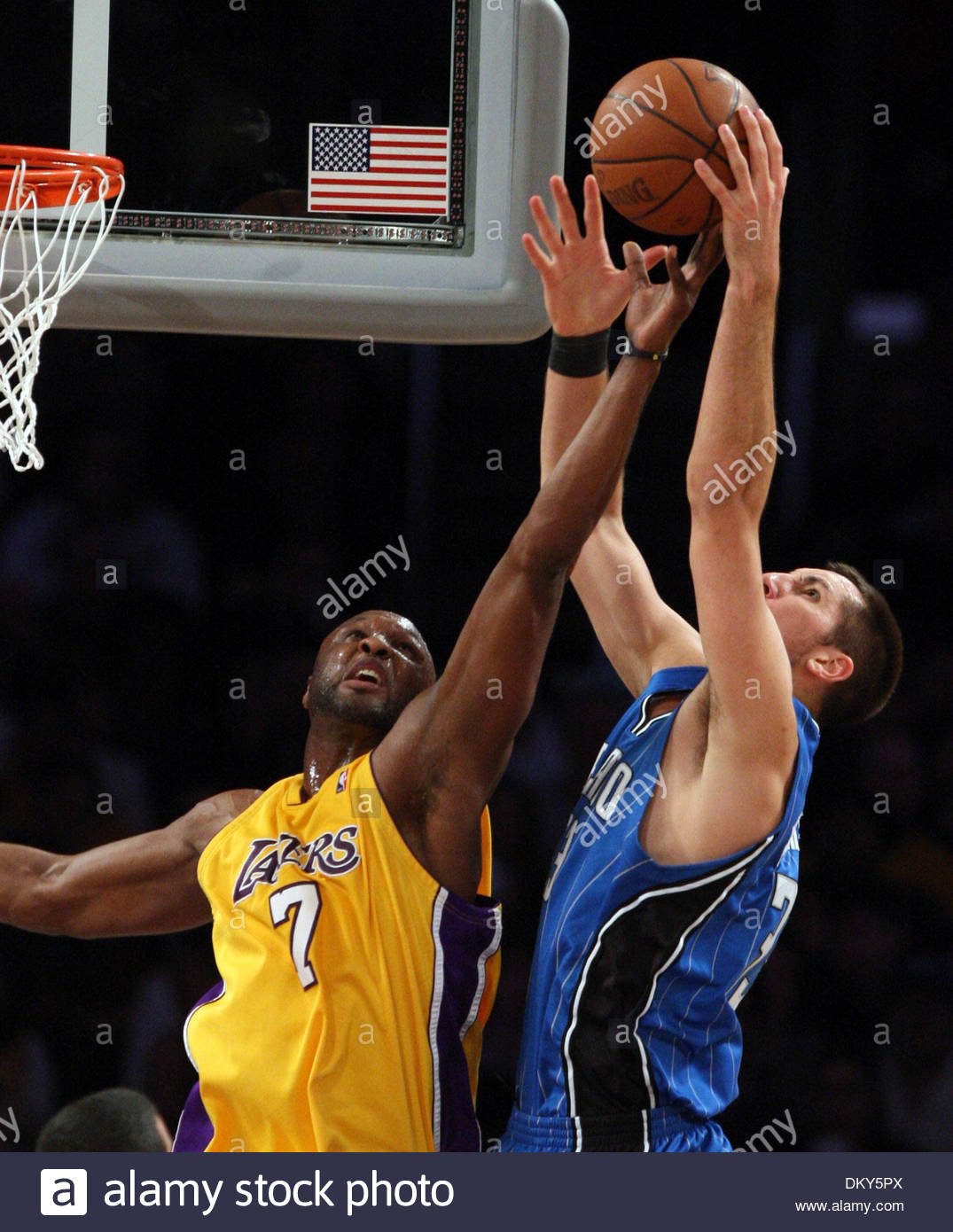Jan. 18, 2010 - LOS ANGELES, California, United States - Los Angeles Lakers' Lamar Odom (7) fights for  the loose ball with Orlando Magic's Ryan Anderson (33) in the first half of a basketball game at the Staples Center on Monday, January 18, 2010 in Los Angeles. (Credit Image: © San Gabriel Valley Tribune/ZUMApress.com) - Stock Image