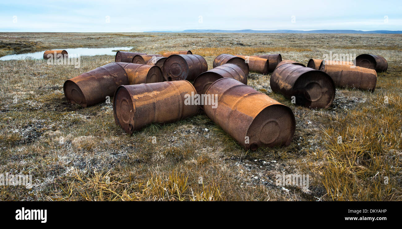 Rusted drums in the tundra, Mammoth River, Wrangel Island, Russian Far East, Unesco World Heritage Site - Stock Image