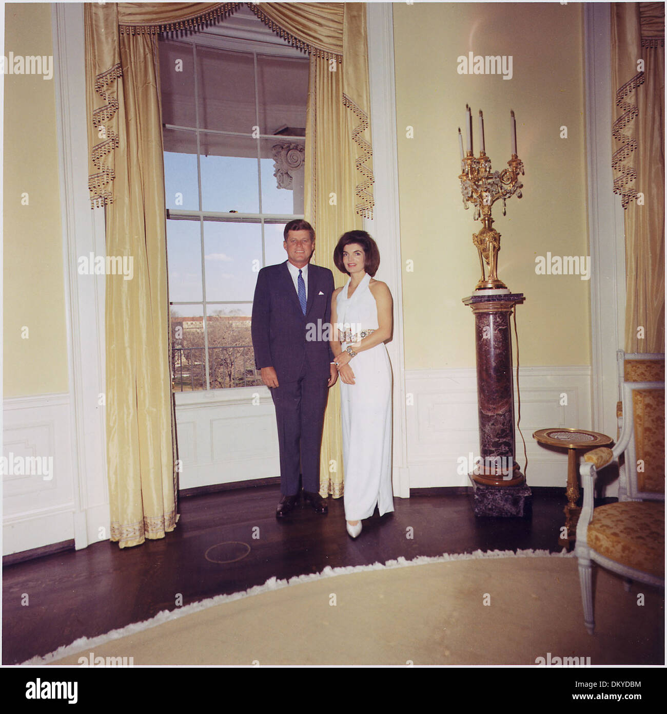 President and First Lady, Portrait Photograph. President Kennedy, Mrs. Kennedy. White House, Yellow Oval Room. 194262 - Stock Image