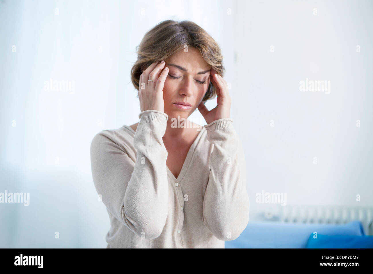 WOMAN WITH HEADACHE - Stock Image