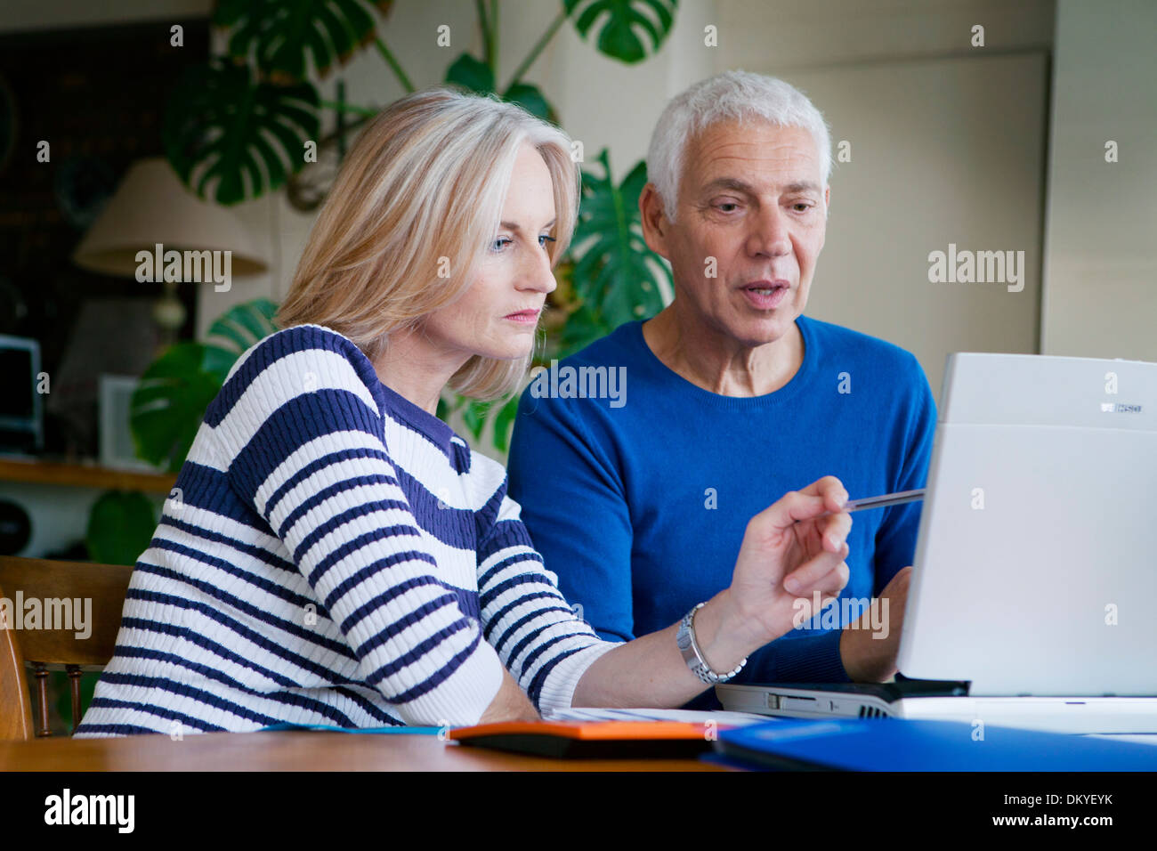 COUPLE DOING PAPERWORK - Stock Image