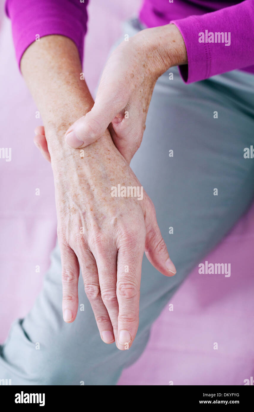 PAINFUL WRIST IN AN ELDERLY PERSON - Stock Image