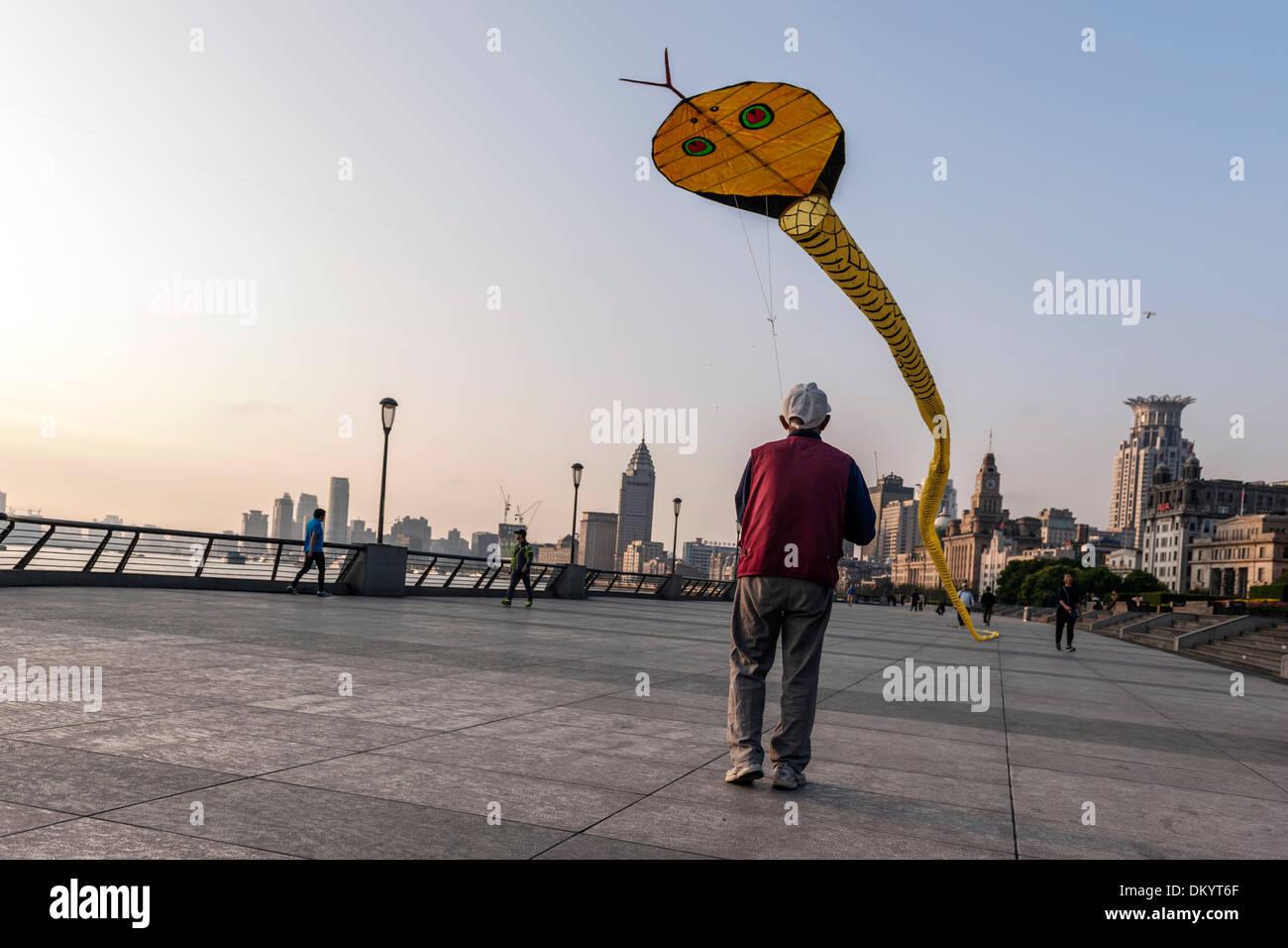 Kite flying at the Bund, waterfront, sunrise, Shanghai, China - Stock Image