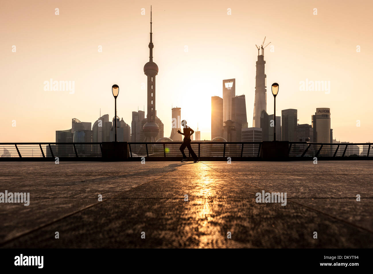 Sunrise on the Bund, waterfront, skyline of Pudong, Shanghai, China - Stock Image