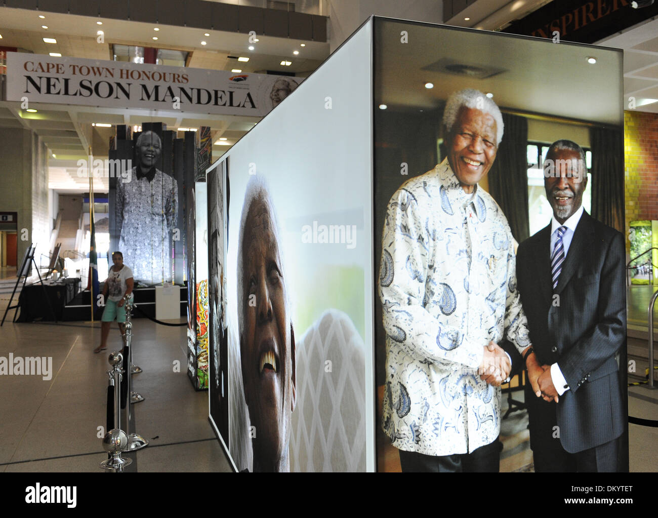 Cape Town, South Africa. 8th Sep, 2013. The City of Cape Town is hosting a photo exhibition of the late President Nelson Mandela in the Civic Centre in Cape Town, South Africa. Visitors also placed flowers and wrote condolence messages.  Photo by Roger Sedres/ImageSA/Alamy Live News - Stock Image