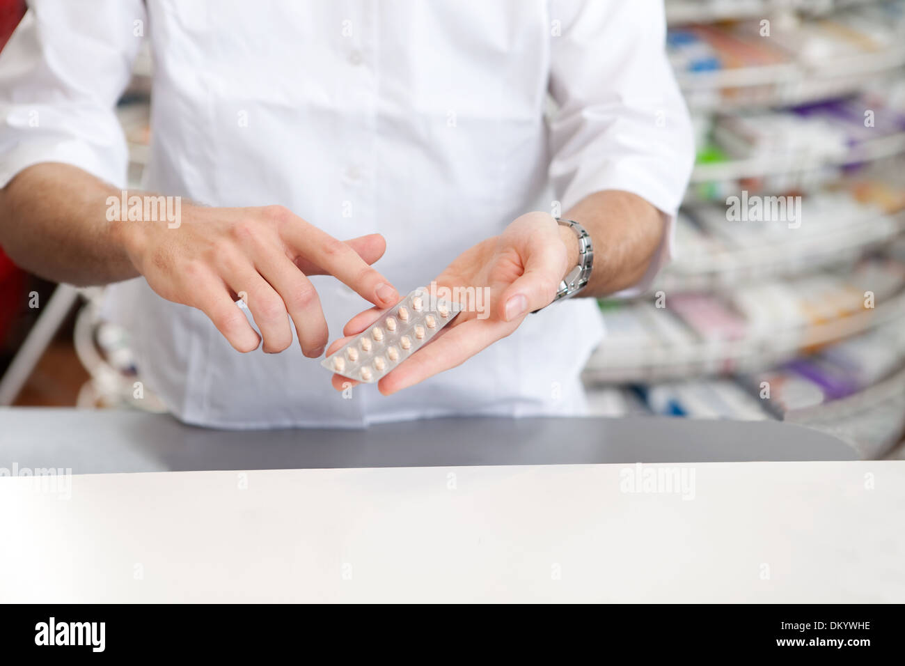 Male Pharmacist Giving Prescription Medicine - Stock Image