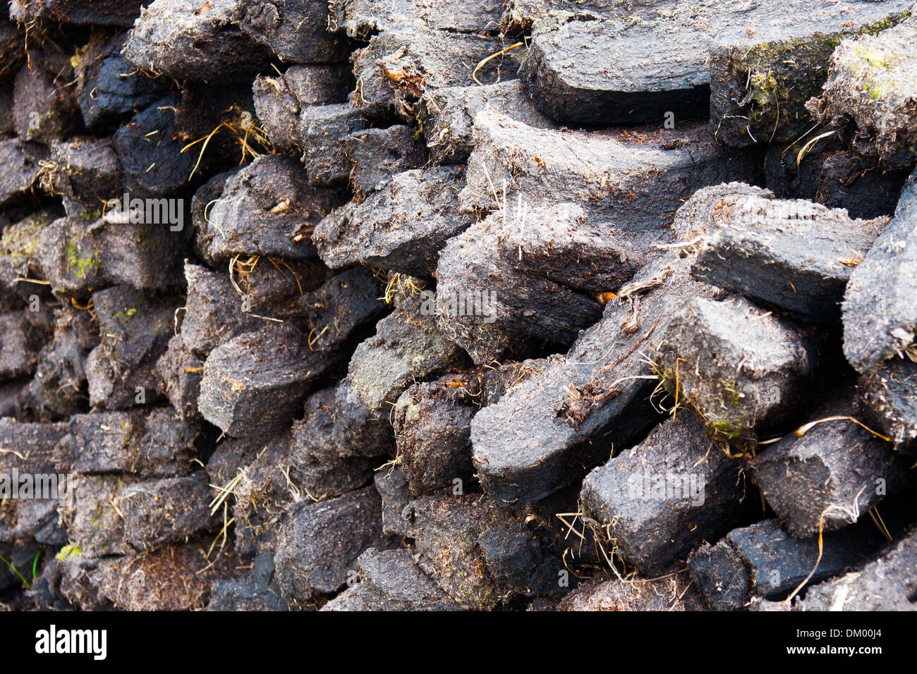 Sods of turf in a reek in the west of Ireland - Stock Image