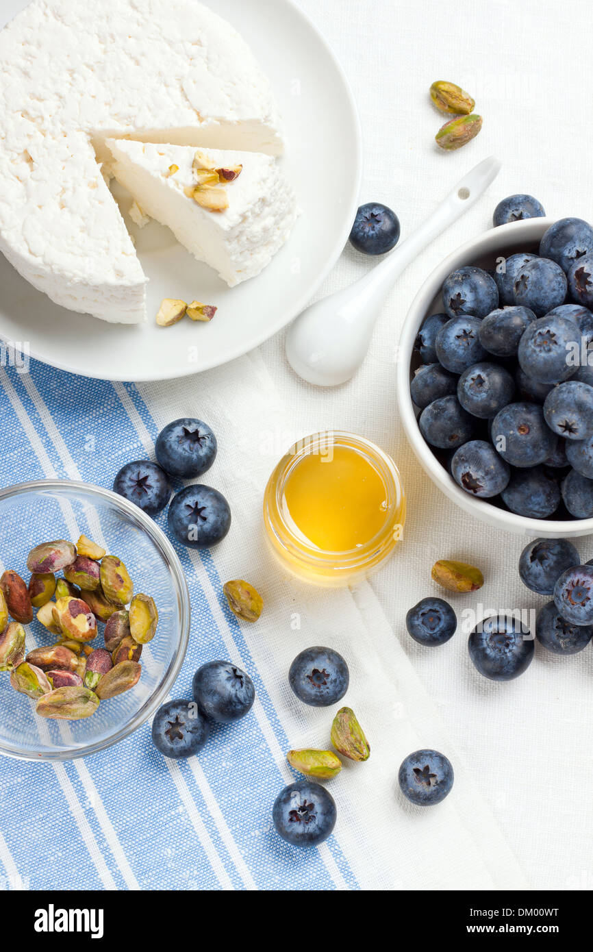 Homemade cottage cheese with berries and nuts, shot from above - Stock Image