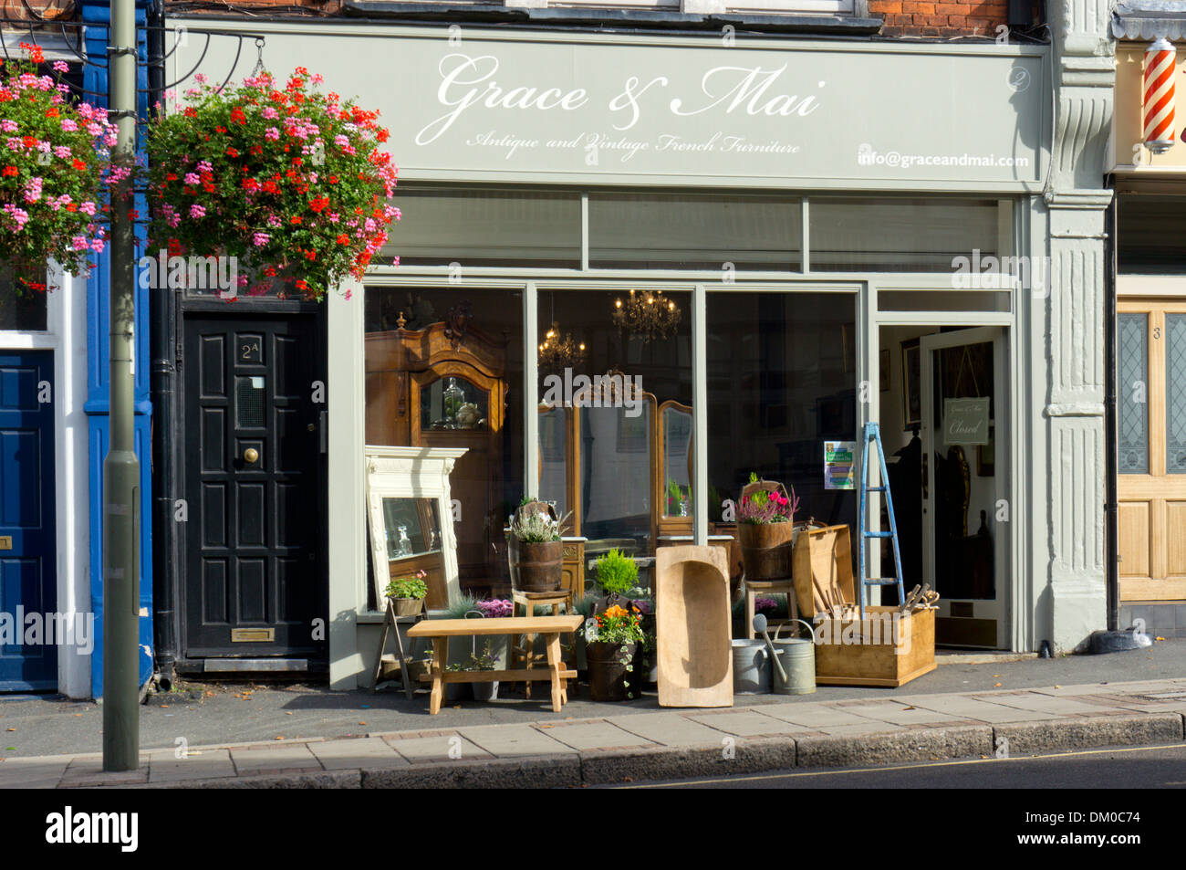 Furniture on the pavement outside the shop of Grace & Mai Antique and Vintage French Furniture in Sundridge Park, Kent. - Stock Image