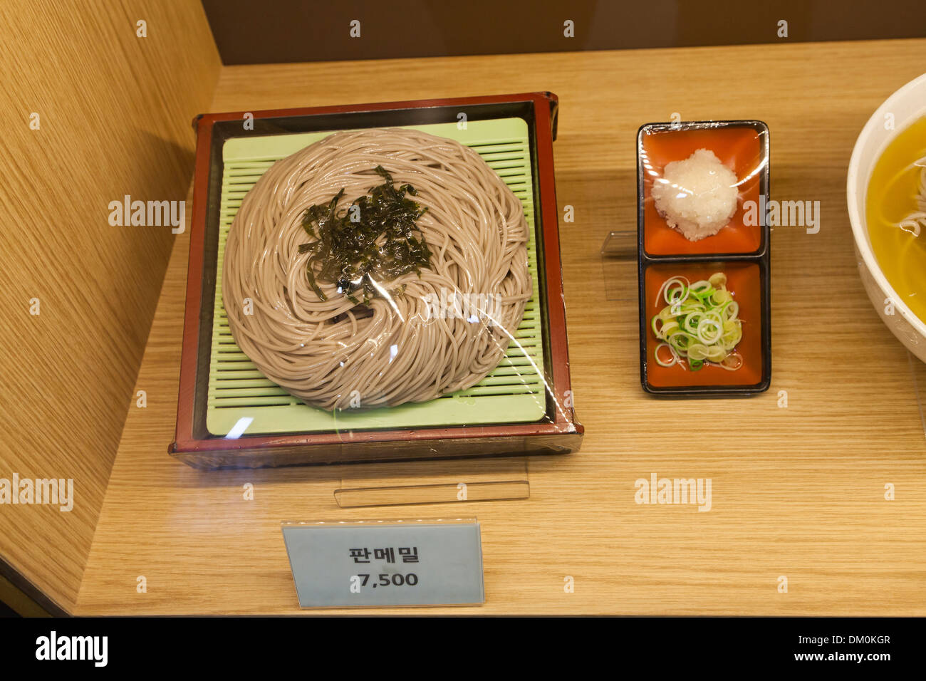 Plastic food  model (buckwheat noodles) display case at fast food restaurant - Seoul, South Korea - Stock Image