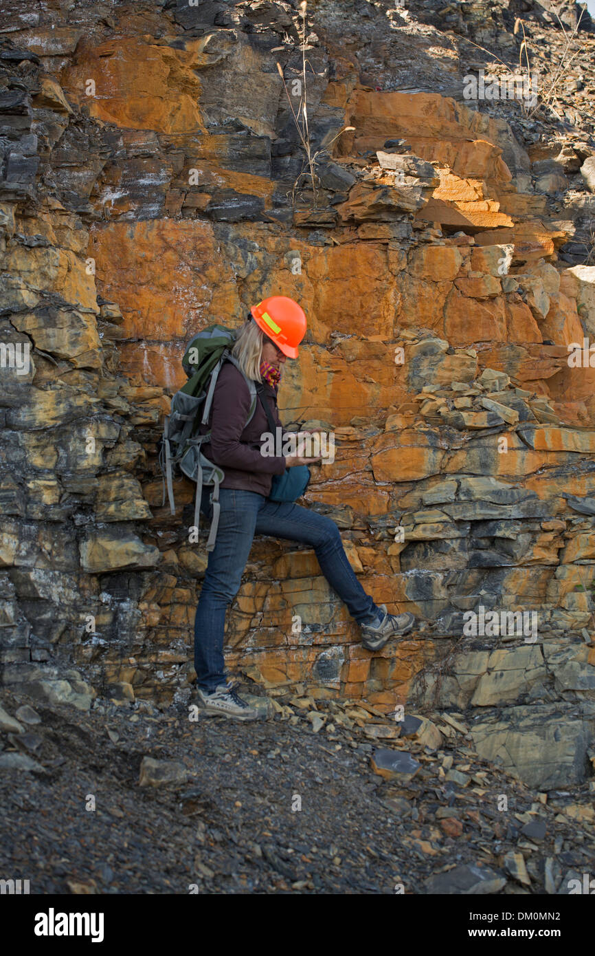 Female Geologist examining Marcellus shale, near Marcellus New York