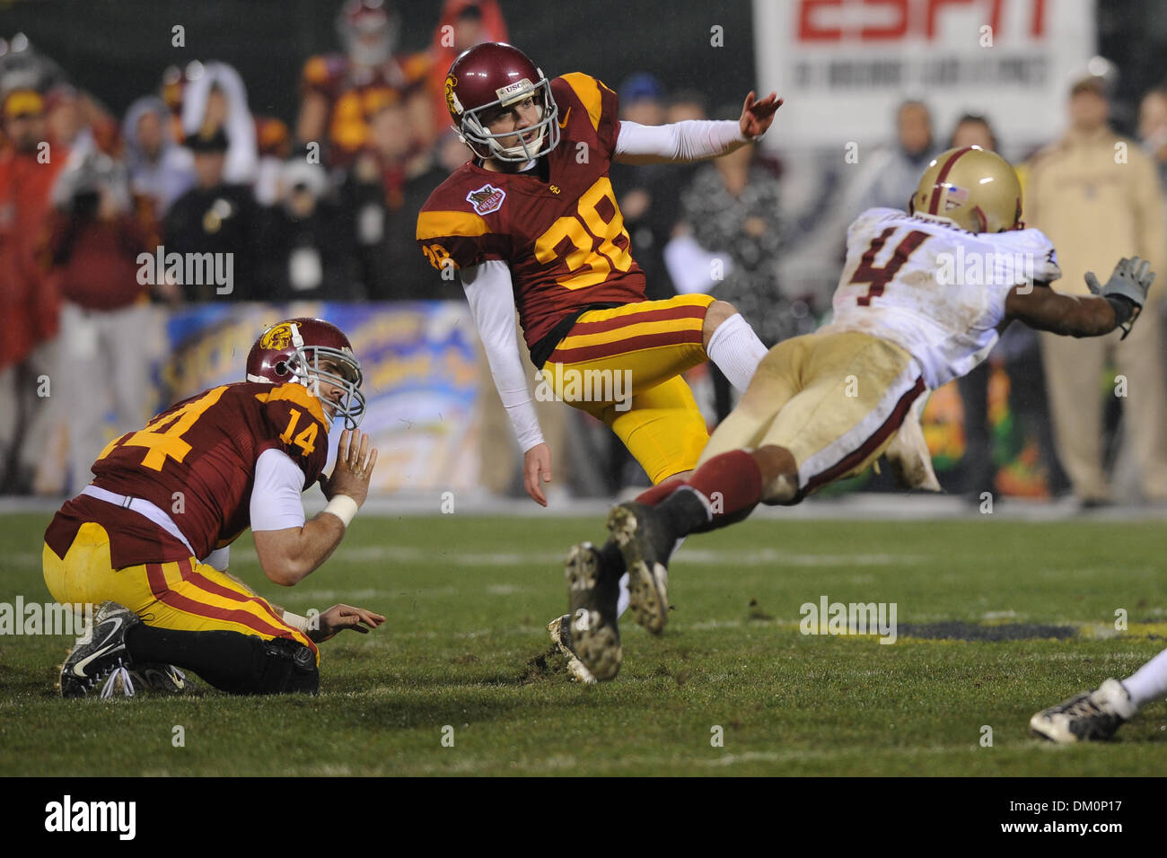Dec. 26, 2009 - San Francisco, California, U.S - 26 December 2009:Boston College SO CB Donnie Fletcher (4) dives as USC SR PK Jordan Congdon (38) misses a field goal during the Emerald Bowl contest between USC and Boston College at AT&T Park in San Francisco, CA.  USC won 24-13. (Credit Image: © Matt Cohen/Southcreek Global/ZUMApress.com) - Stock Image