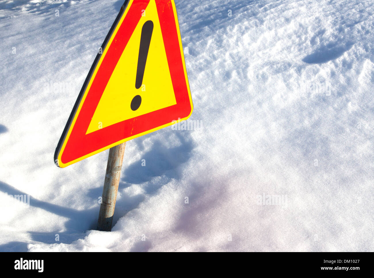Warning sign and snow. Exclamation mark. - Stock Image