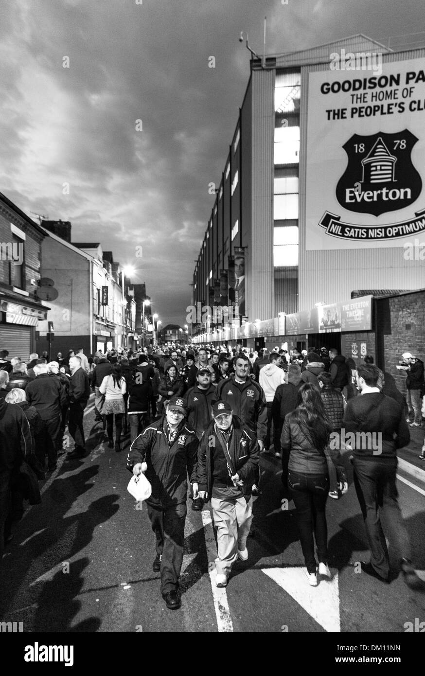 Football fans arriving at Goodison Park before the game between Everton and Newcastle Utd. Liverpool, UK Stock Photo