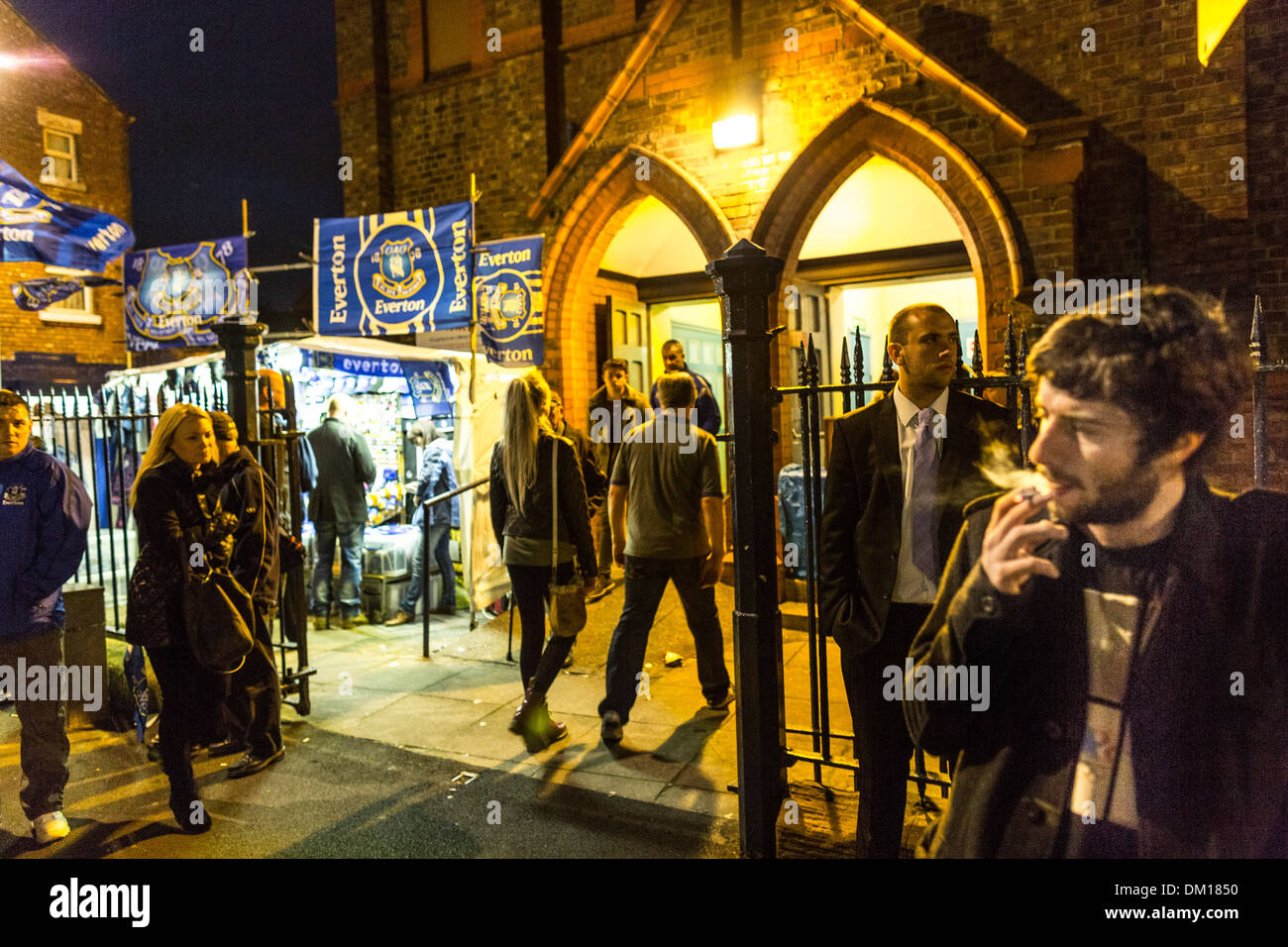 Football fans outside St Lukes Church, Goodison Road, before the midweek game between Everton and Newcastle Utd - Stock Image