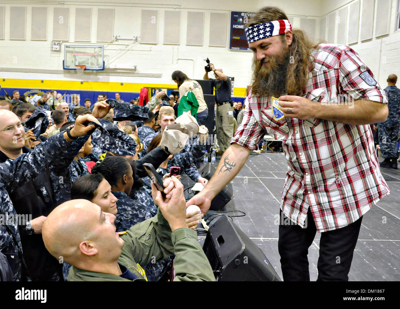 Duck Dynasty reality television star Willie Robertson signs autographs and poses for photos after a USO performance at Naval Support Activity December 7, 2013 in Souda Bay, Greece.  Robertson's visit is part of the annual USO holiday tour to help boost the moral of service members deployed overseas. - Stock Image