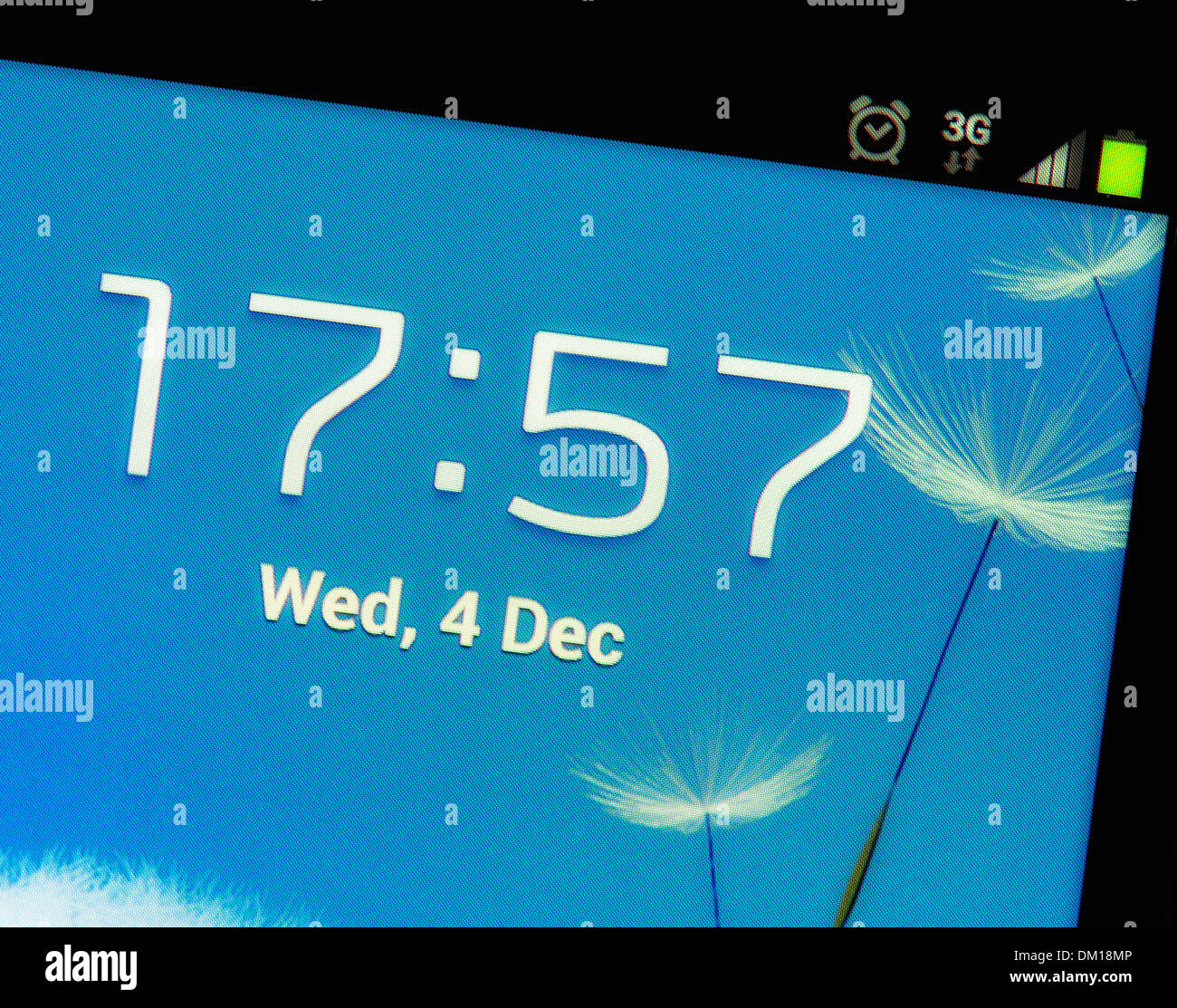 A mobile phone touch screen showing time date 3g and signal strength Samsung Galaxy range - Stock Image