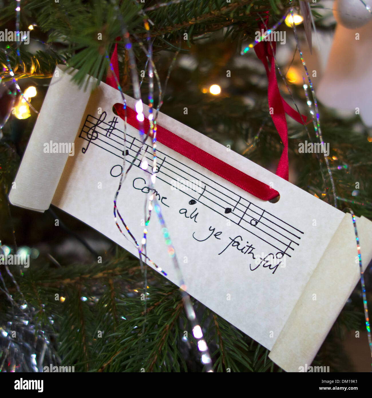 O Come All Ye Faithful: Christmas carol lyrics on a Christmas tree ...
