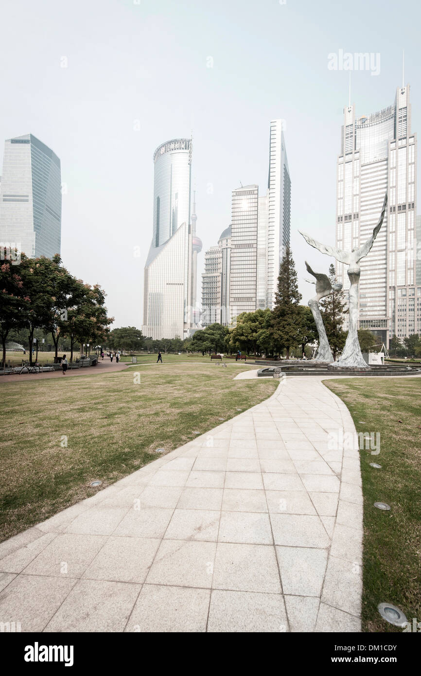 Sculptures and skyscrapers, Lujiazui Green Park, Lujiazui, Pudong, Shanghai, China - Stock Image