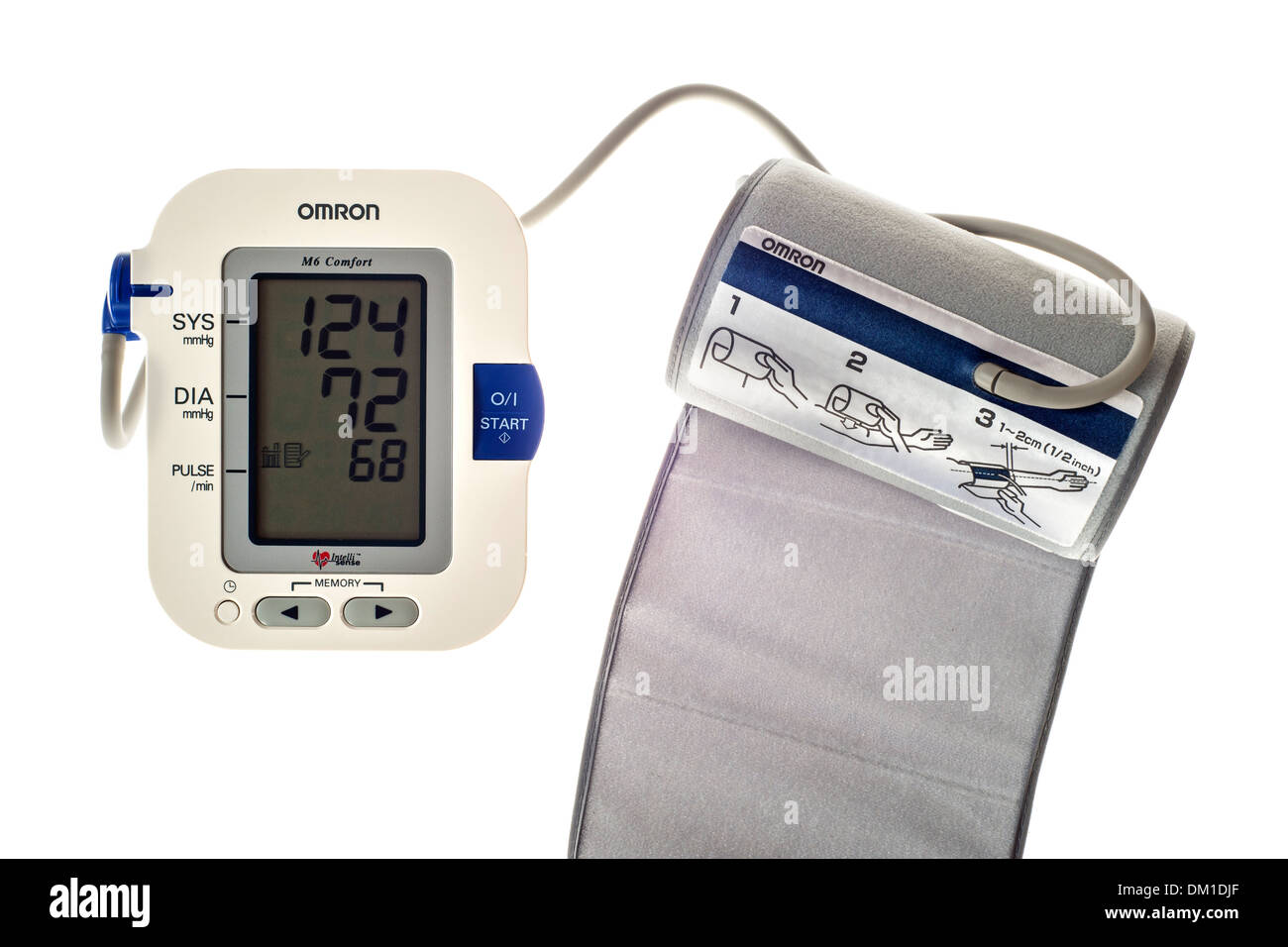 Close up of digital blood pressure monitor on white background - Stock Image