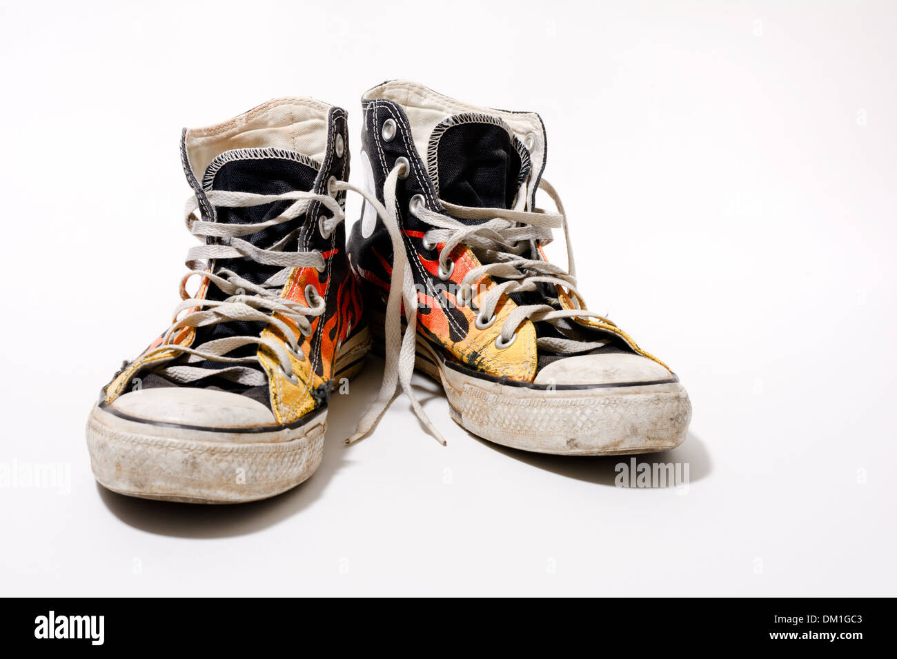 ae66bc3c815 Worn and dirty Converse All Star shoes isolated on white background - Stock  Image