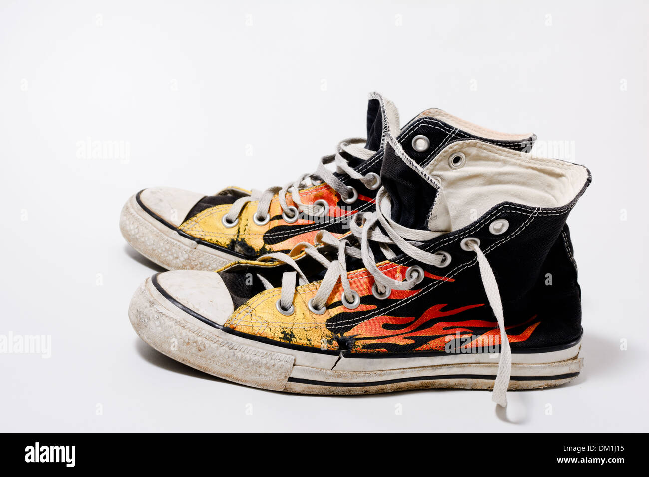 Worn and dirty Converse All Star shoes isolated on white background - Stock Image