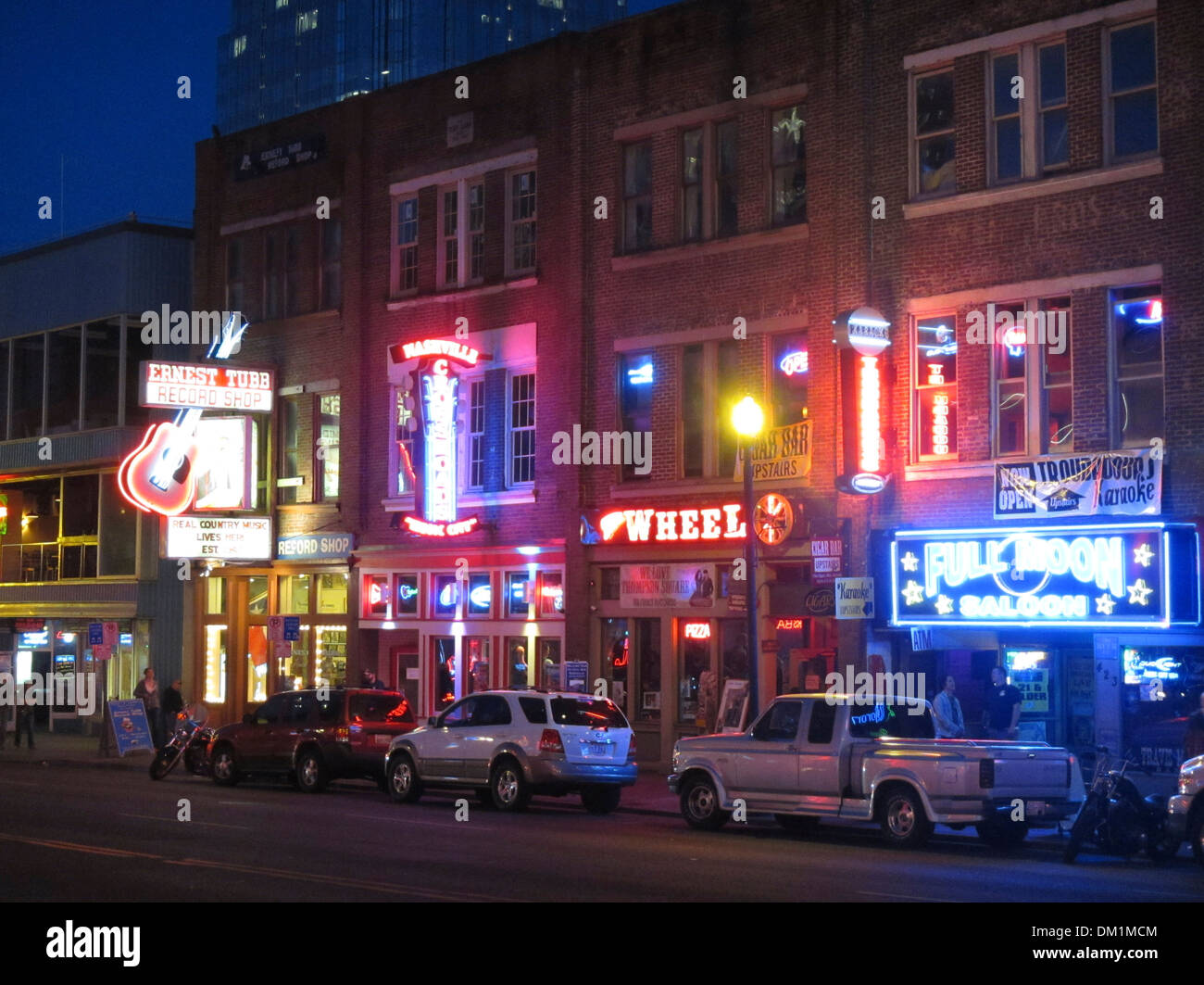 Honky tonk bars and clubs line Broadway in downtown Nashville, Tennessee - Stock Image