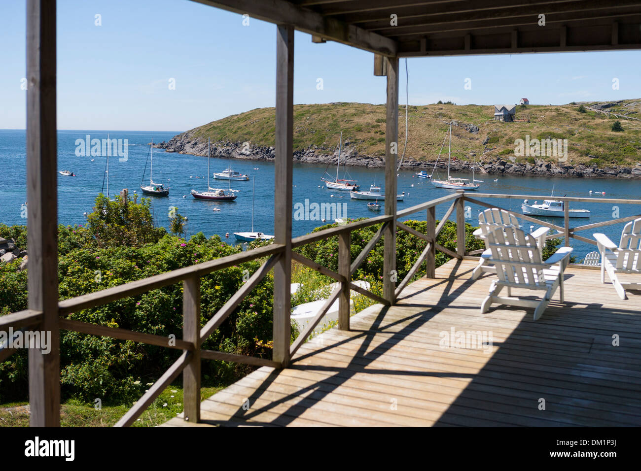 A view of Monhegan Island's harbor from the porch of a small hotel there. Monhegan is an offshore island belonging to Maine, USA - Stock Image