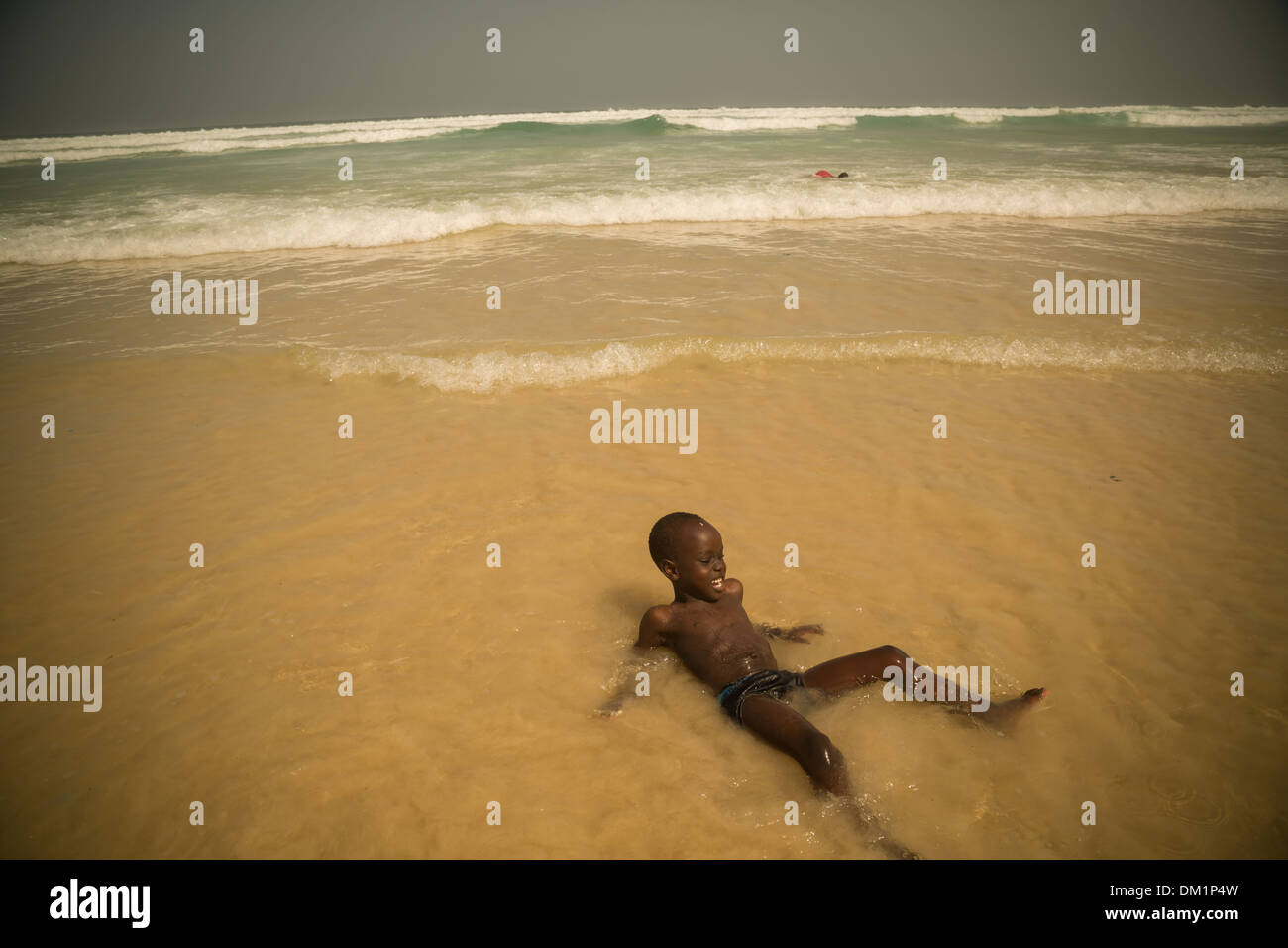 Child at Yaf beach Dakar, Senegal Stock Photo
