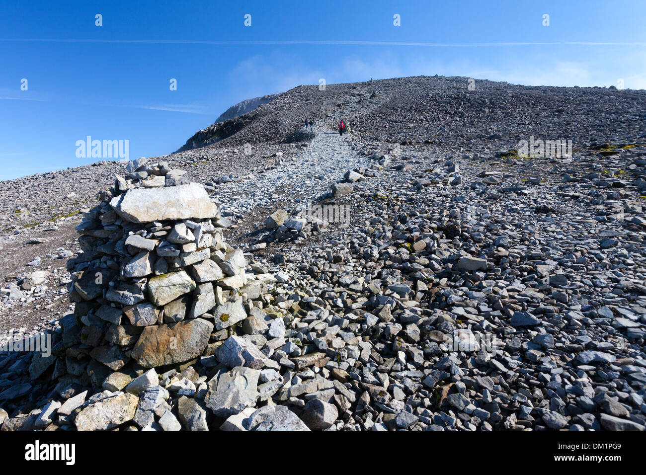 Ben Nevis in the Scottish Highlands, the pony track footpath, marked by rock cairns, approaching the summit with light cloud in the distance. - Stock Image