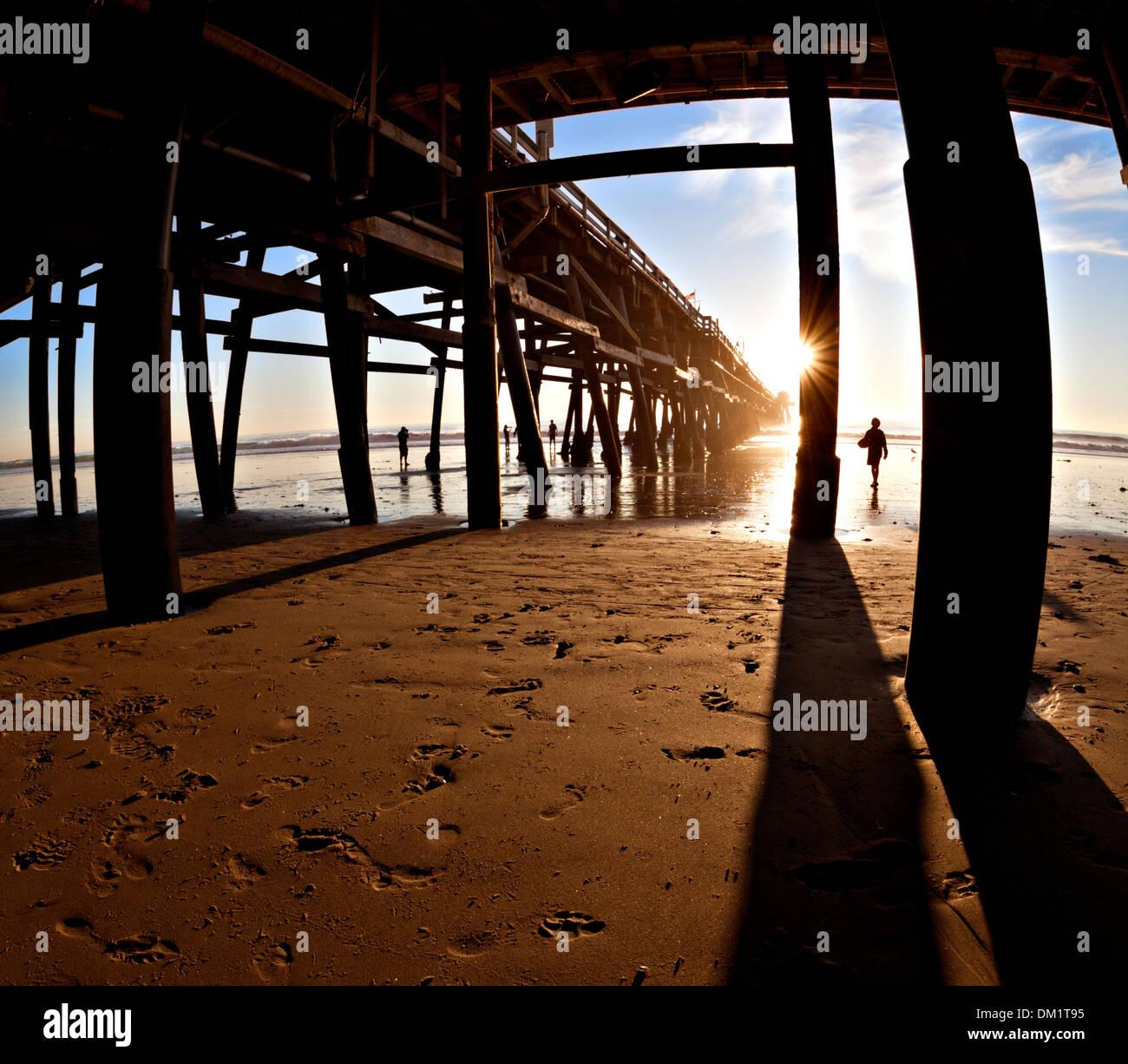 Surfer at sunset, San Clemente Pier, California. Stock Photo