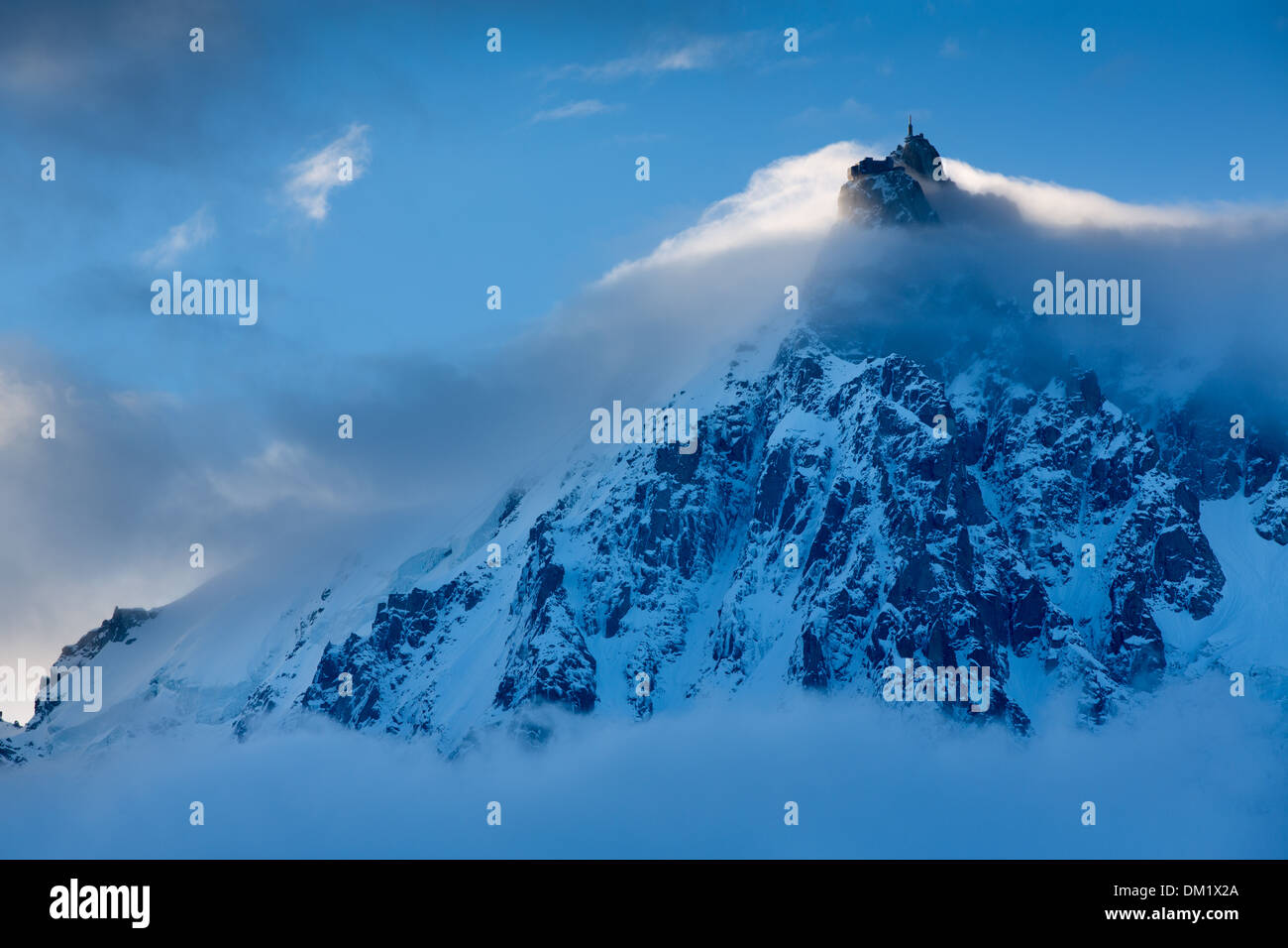 the Aiguille du Midi  appearing through the clouds, Mont Blanc, les Alps, Haute-Savoie, France Stock Photo