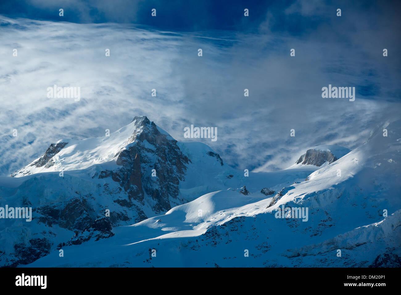 Mont Blanc du Tacul appearing through the clouds, les Alps, Haute-Savoie, France - Stock Image