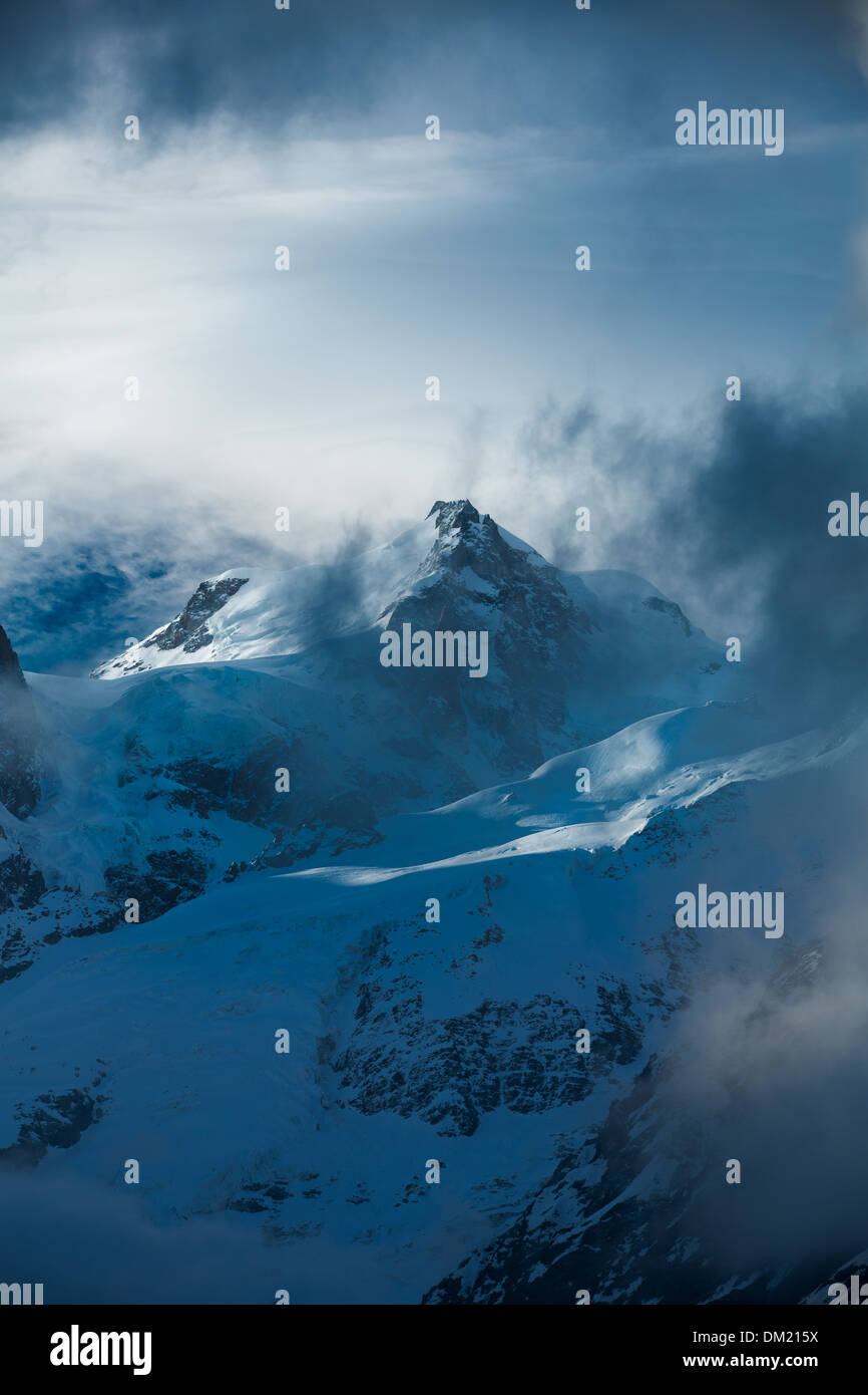 Mont Blanc appearing through the clouds, les Alps, Haute-Savoie, France - Stock Image