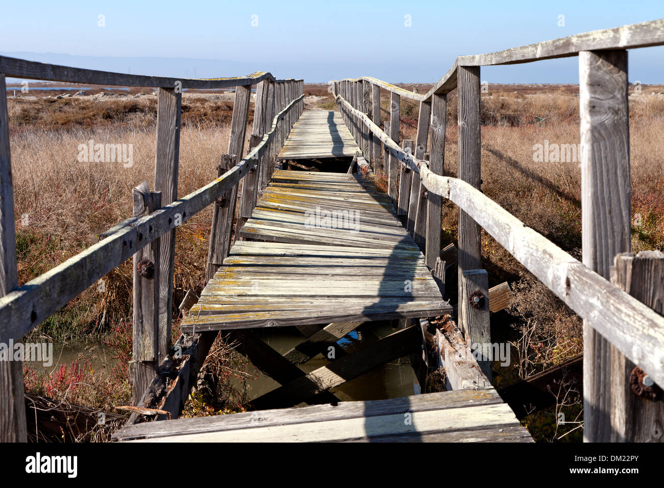 A foot bridge crosses the marsh at the ghost town of Drawbridge in southern San Francisco Bay. - Stock Image