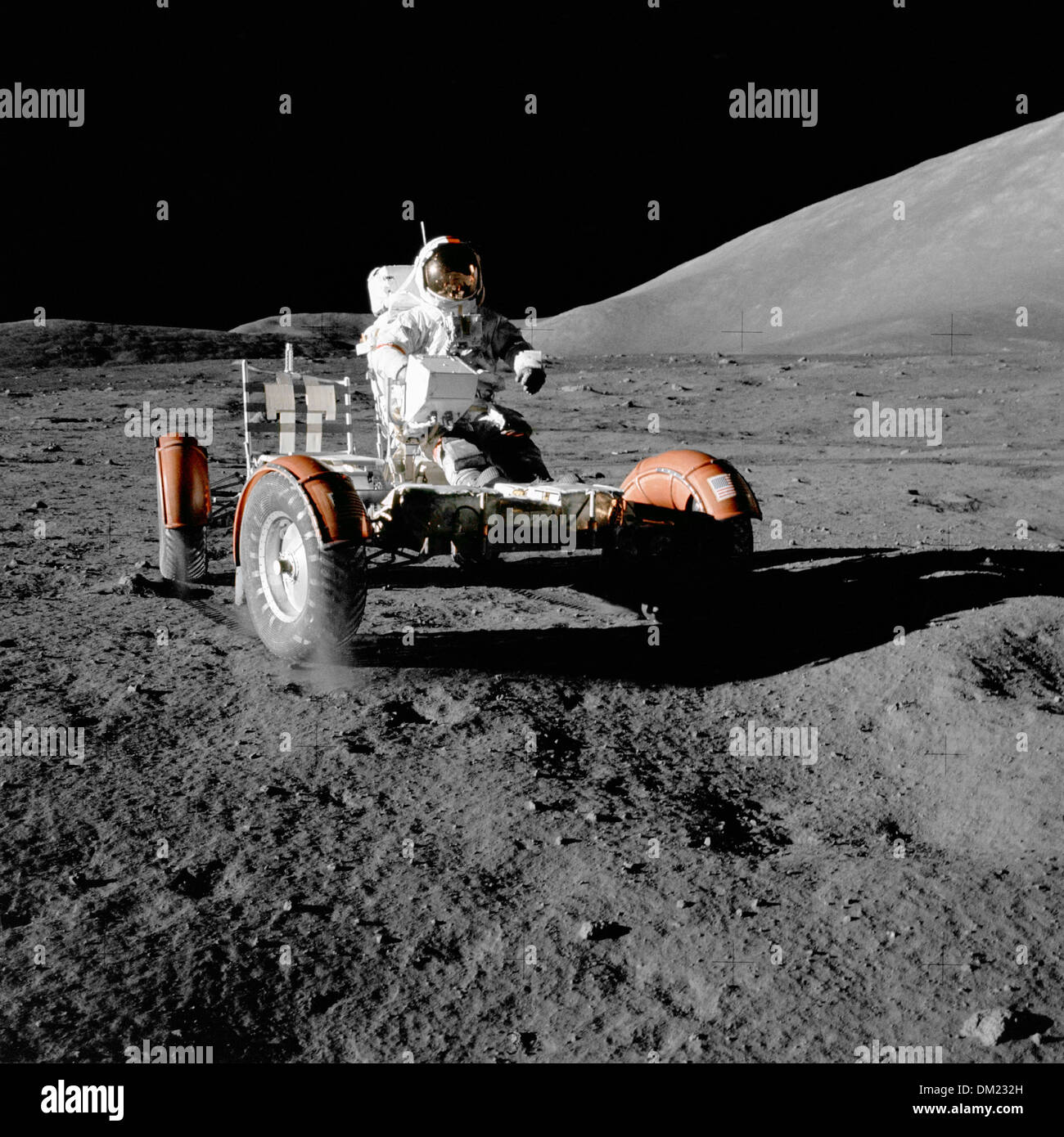 NASA Apollo 17 Astronaut and Mission Commander Eugene Cernan aboard the Lunar Rover during the first EVA of the mission on the lunar surface December 11, 1972. Apollo 17 was at the final expedition to the moon for the space program. - Stock Image