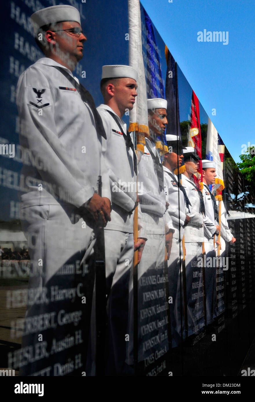 US Navy honor guard are reflected on the memorial pillars to service members who lost their lives in the attack on Pearl Harbor during the 72nd Anniversary Commemoration December 7, 2013 in Honolulu, Hawaii. - Stock Image