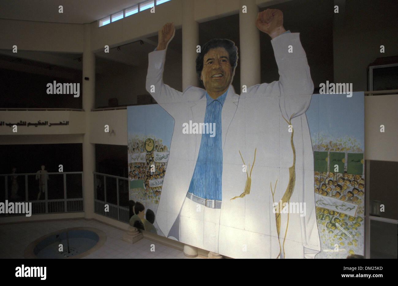 Muamar Muhamad Abu-minyar el Gadafi  poster in the archaeological Museum of Leptis Magna, - Stock Image