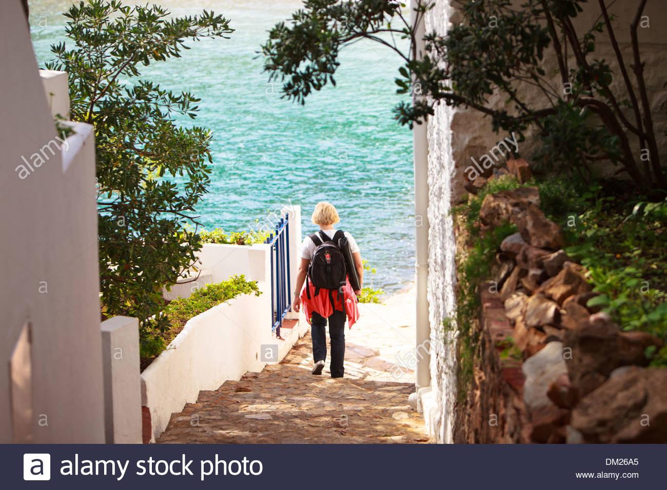Tourist near Sa Tuna beach, Costa Brava, Catalonia, Spain - Stock Image