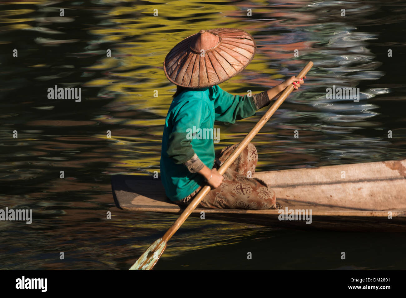 a woman paddling on Inle Lake, Myanmar (Burma) - Stock Image