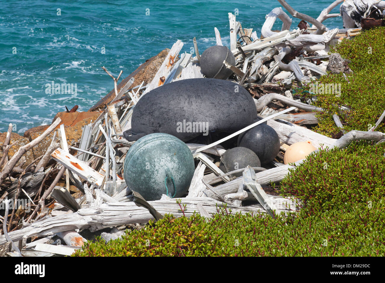Floats and other marine debris entangled with driftwood washed ashore on a North Pacific island Stock Photo