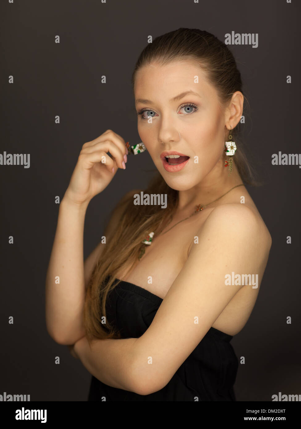 portrait of beautiful brown long hair caucasian female brown and green eyes open mouth wondering - Stock Image