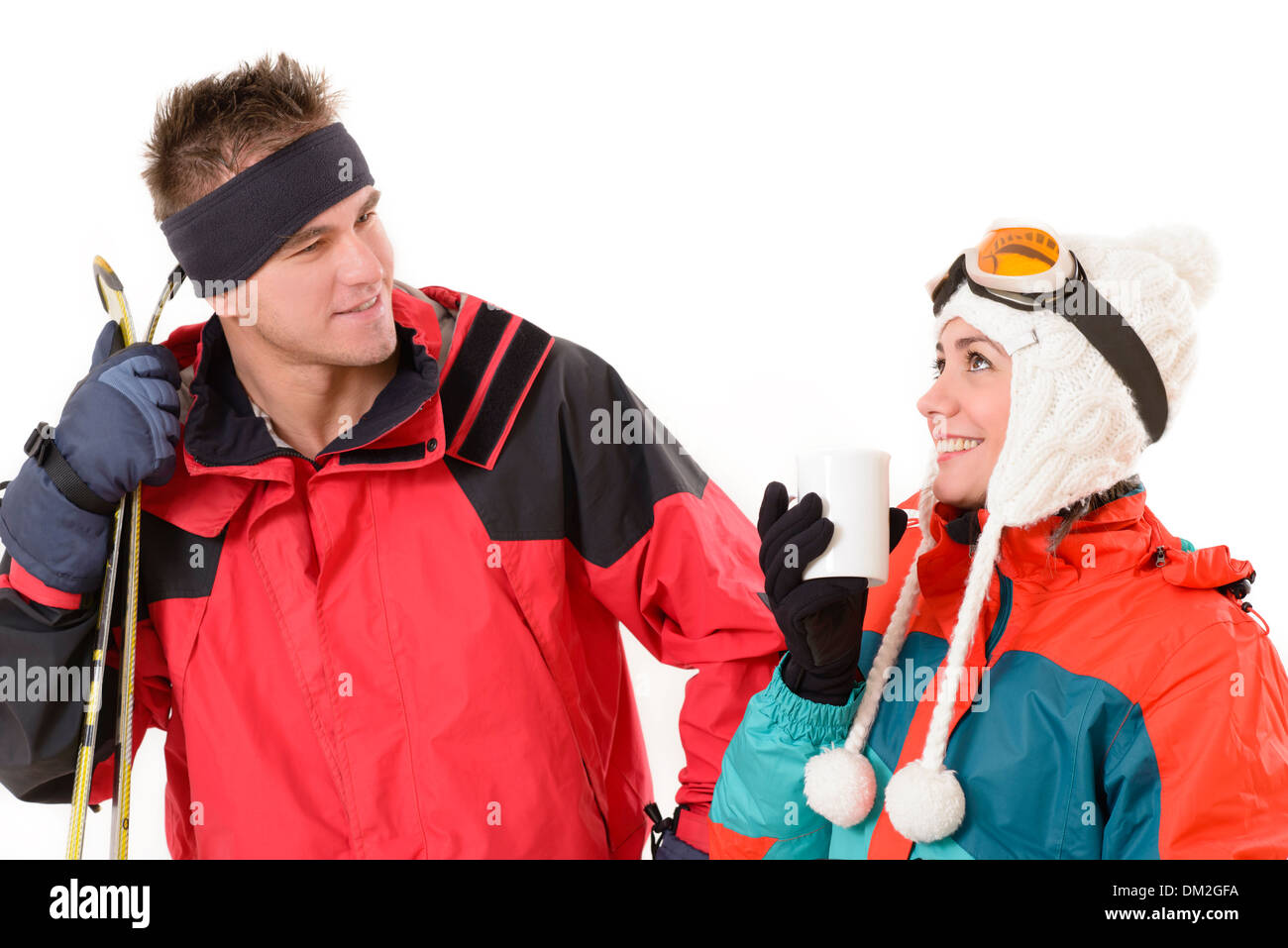 Happy couple in ski suit relaxing isolated on white - Stock Image