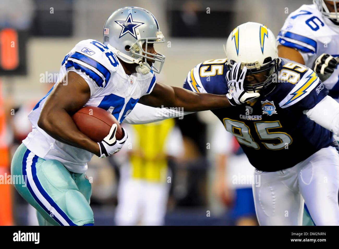 Dallas Cowboys Running Back Felix Jones 28 Stiff Arms San Diego Chargers Linebacker Shaun Phillips 95 In The NFL Football Game Between